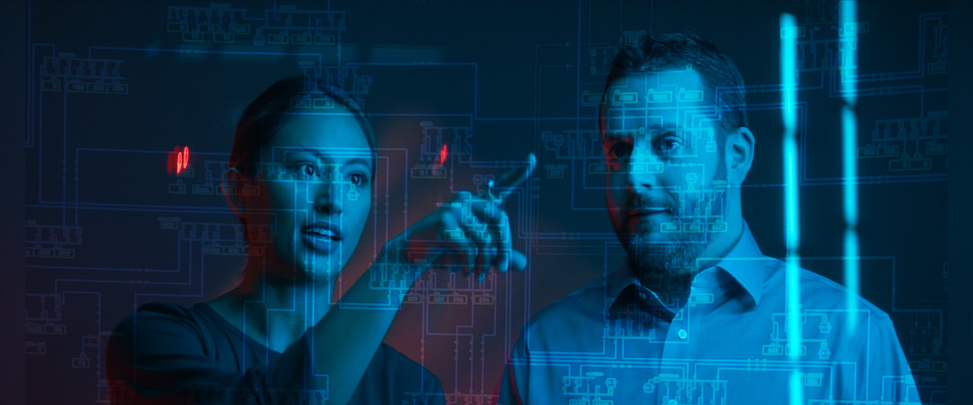 Two coworkers looking at data